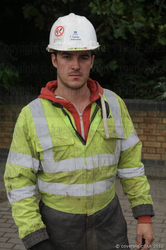 Engineer Wearing a Yellow Grey Hi-vis Phoenix Flame Resistant Coverall. Engineer Wearing Yellow Grey Hi-vis Flame Retardant Coverall 6
