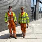 Workman wearing hi-vis Orange Boilersuits and yellow hi-vis waistcoats