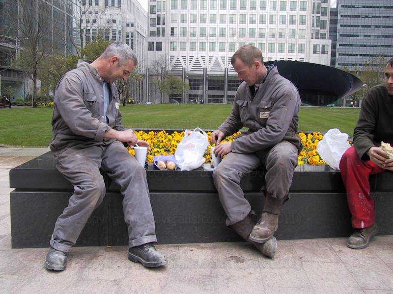Picture of Guys eating lunch wearing grey coveralls