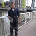 Fitter at Canary Wharf wearing blue coveralls