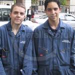 Refrigeration Engineers wearing blue coveralls at Canary Wharf