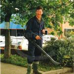 Gardener, wearing blue coveralls