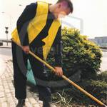 Gardener lad wearing blue boilersuit yellow hi-vis jacket 4