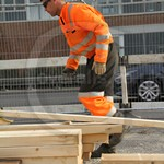 Gas Engineer Workman wearing an Orange/Grey Coverall