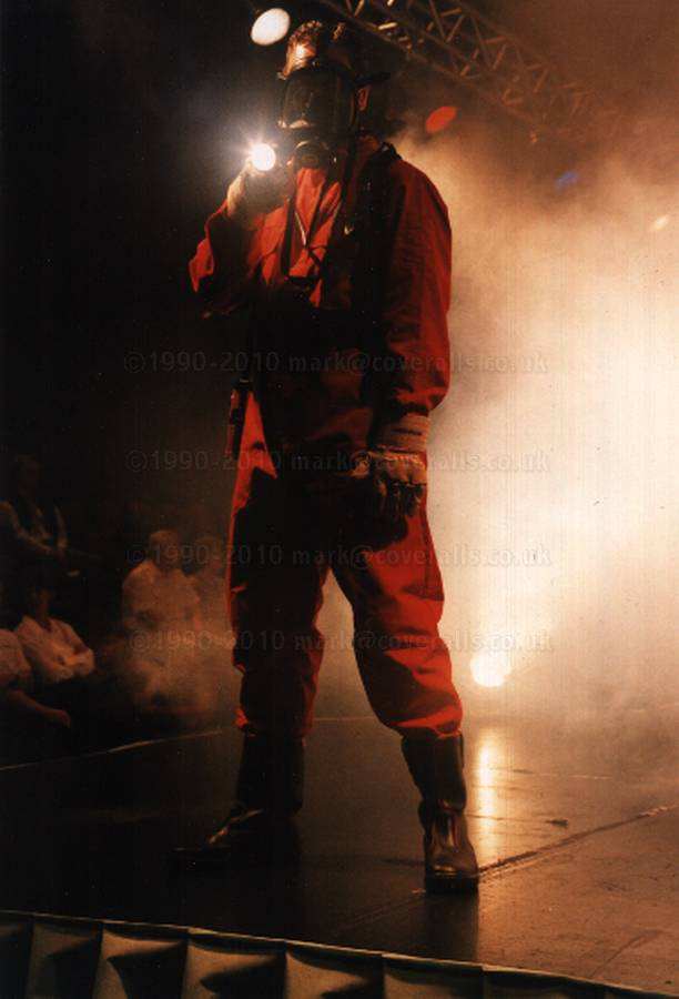 Picture of Catwalk safety show guy wearing red coveralls & BA equipment