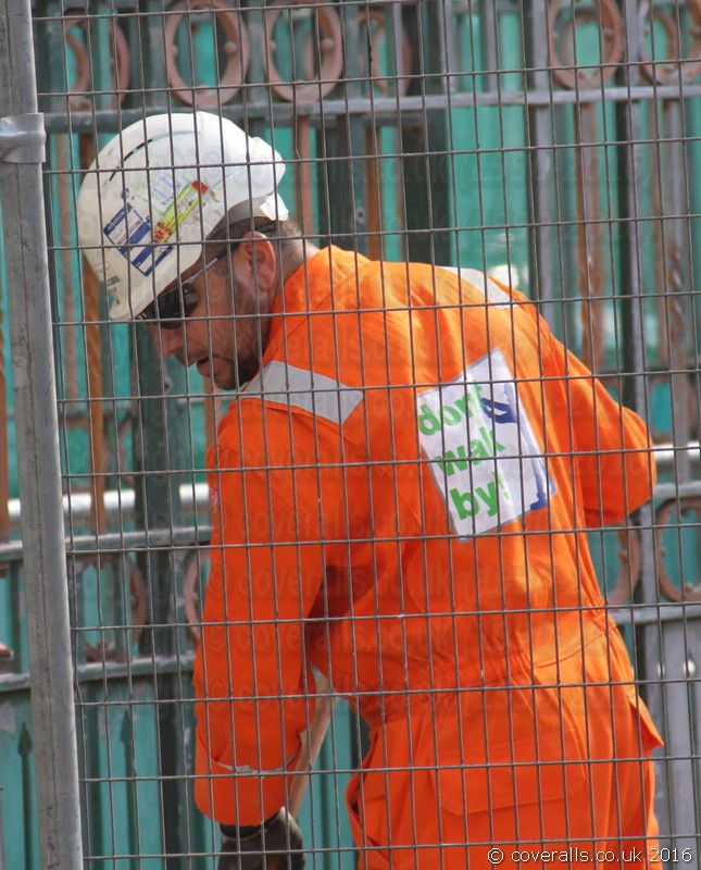Guy wearing a portwest orange biz-flame hi-vis coverall. Guy wearing orange hi-vis coverall 10