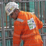 Guy wearing orange hi-vis coverall