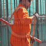Guy wearing a portwest orange biz-flame hi-vis coverall