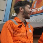 Guy Wearing Roots Orange Hi-vis Coveralls 6