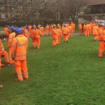 Hundreds of rail workers in a park after a fire drill