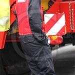 Lad wearing Grimme agricultural coverall at Lord Mayors show