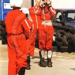 Young displayteam motorcyclists wearing red coveralls