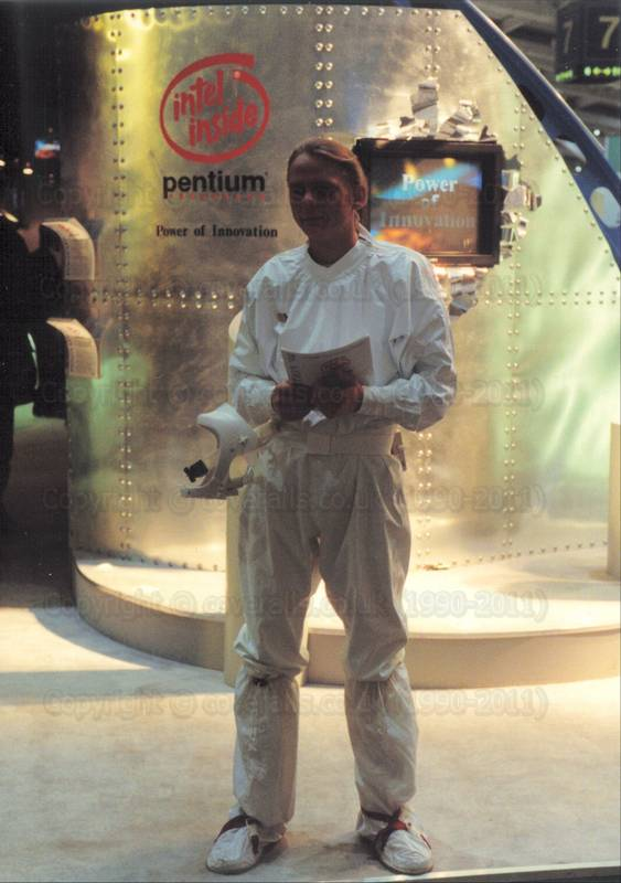 Guy on Intel stand at CeBit, wearing white cleanroom coveralls 1