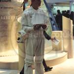 Guy on Intel stand at CeBit, wearing white cleanroom coveralls