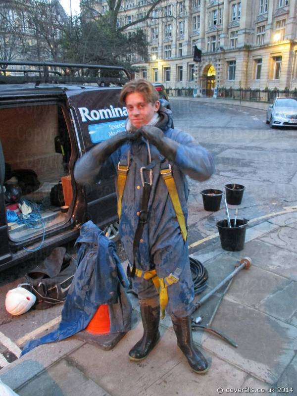 Picture of Young Lad Steam/Jet washing buildings wearing waterproof PVC Coverall