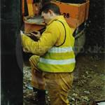 John working in his yellow overalls and hi-viz waistcoat