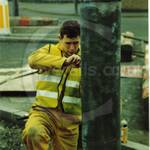 John working in his hi-viz yellow overall