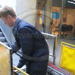 Kone Engineer repairing an Escalator at Canary Wharf