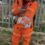 Young lad wearing an Orange ProGARM Boilersuit 10
