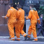 Lads wearing Hi-vis Orange Portwest Bizflame Boilersuits