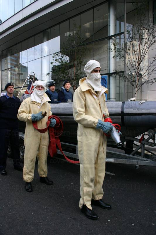 Picture of Guy wearing fearnought overall suit. These overalls are made from white flame retardant woollen cloth (200 layers of compressed wool) and used by Royal Navy personnel for fire fighting on board ships.