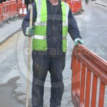 Nikolai installing fibre optic cabling for broadband wearing a blue boilersuit