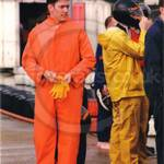 Guy karting in orange waterproof coveralls 1