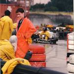 Group of lads go-karting wearing waterproof PVC coveralls during a downpour on the track