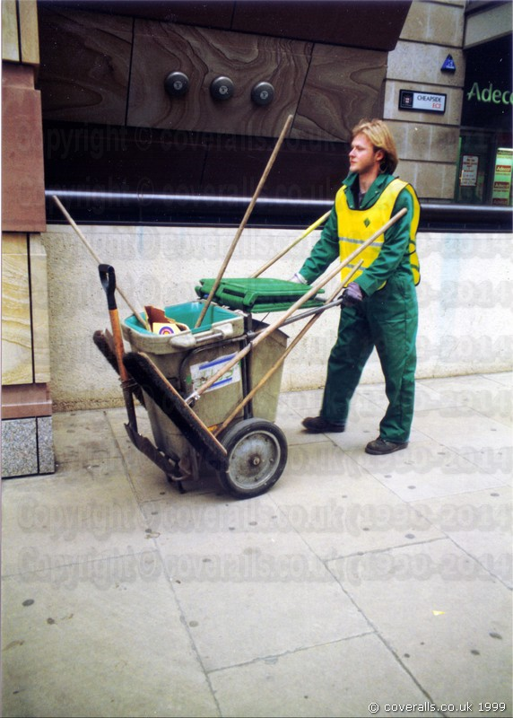 Oliver the road sweeper, wearing green coveralls and yellow hi-vis tabard 2