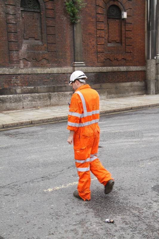Railway Engineer wearing orange hi-viz coveralls 1