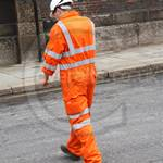Railway Engineer wearing orange hi-viz coveralls