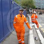 Pest controller working wearing an orange hi-viz pioner riggmaster coverall