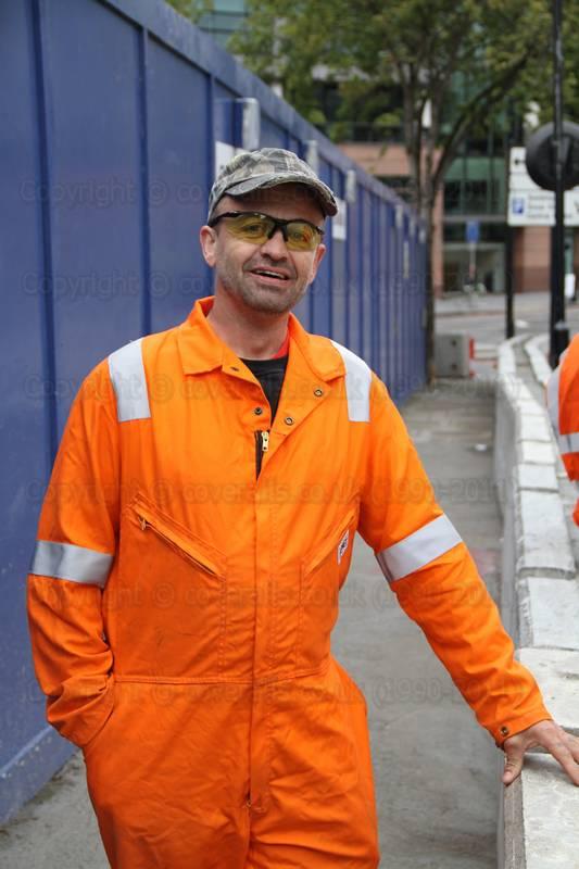 Guy Wearing An Orange Hi Viz Pioner Riggmaster Coverall