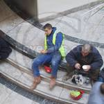 Guy in blue overalls Canary Wharf
