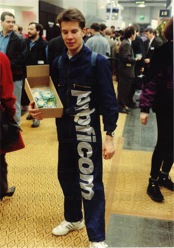Young Guy in dark blue zip coverall wth large silver lettering down one leg at Cebit Hannover Messe 1994. Young Guy in dark blue zip coverall at Cebit Hannover Messe 1994 1