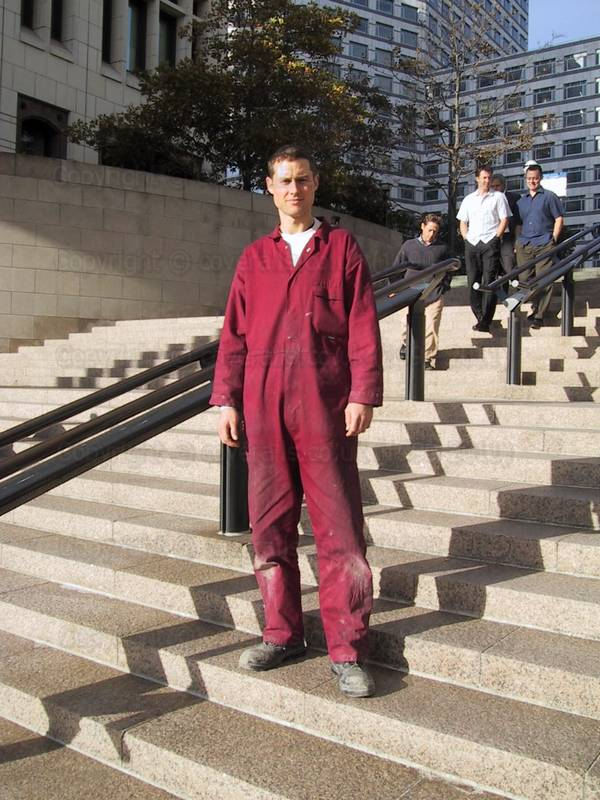 Picture of Good looking sexy male Plumber at Canary Wharf wearing maroon coveralls