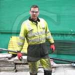 Power Utility Workman Wearing Hi-vis Yellow/Blue Boilersuit Overall