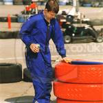 Lads go-karting wearing karting racesuit overalls