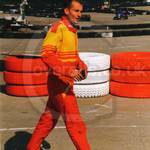 Guy working at go-karting track wearing red/yellow karting race suit