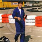 Mechanic working at Go-karting track wearing blue overalls