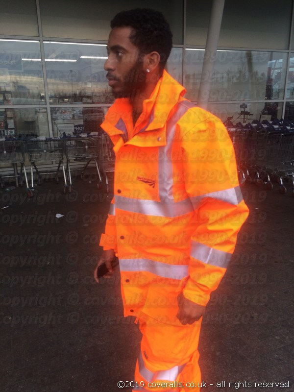 The GORE-TEX Fabric provides full durable, waterproof and windproof protection while offering the highest levels of breathability. Rail worker wearing Ballyclare GORE-TEX Hi Vis Waterproof Thermal Coverall 1