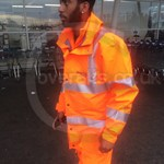 Rail worker wearing Ballyclare GORE-TEX Hi Vis Waterproof Thermal Coverall