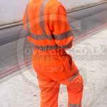 Rail worker wearing Pulsarail Hi-Vis Orange Coverall