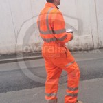 Rail worker wearing Pulsarail Rail Spec Orange Combat Coverall