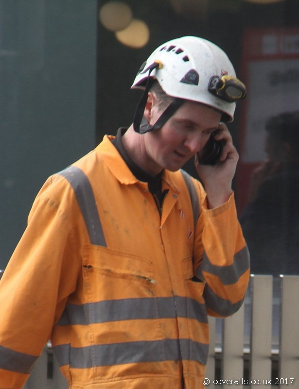 Rail Workman wearing an Orange Hi-vis Coverall 2