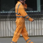 Rail Workman wearing an Orange Hi-vis Coverall
