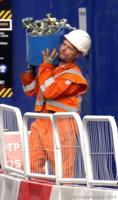 Rail worker wearing a pair of orange Hi-vis Coveralls. Rail Worker Orange Hi-vis Coverall 1