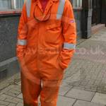 Rail worker wearing Orange Hi-vis Modaflame Coveralls Boilersuit from Portwest