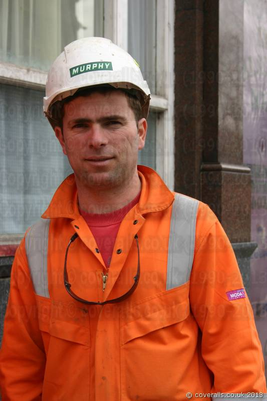 Rail worker wearing Orange Hi-vis Modaflame Coveralls Boilersuit from Portwest. Rail Worker Orange Portwest Modaflame Coveralls 7