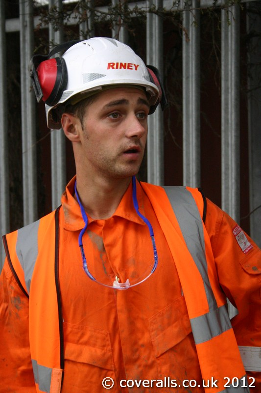 Railworker wearing Orange Hi-vis Bizflame Boilersuit from Portwest. Railworker Portwest Orange Hi-vis Bizflame Boilersuit 6